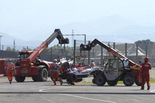 Antonio Giovinazzi's Alfa Romeo Racing C39 is recovered by marshals