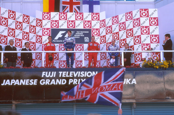 Suzuka, Japan.11-13 October 1996.Damon Hill (Williams Renault) 1st position, Michael Schumacher (Ferrari) 2nd position and Mika Hakkinen (McLaren Mercedes) 3rd position on the podium. Also Adrian Newey to the right of him.Ref-96 JAP 06.World Copyright - LAT Photographic