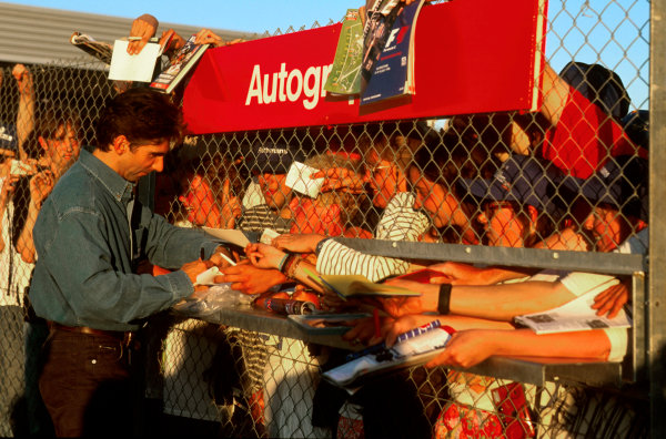 Silverstone, England.12-14 July 1996.Damon Hill gives his fans some autographs.Ref-96 GB 24.World Copyright - LAT Photographic