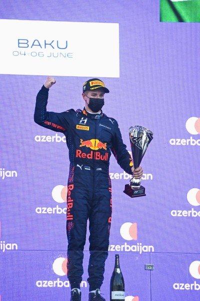 Juri Vips (EST, Hitech Grand Prix), 1st position, on the podium with his trophy