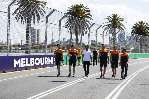 Carlos Sainz, McLaren and members of the team walk the track