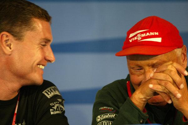 2002 USA Grand Prix - PreviewIndianapolis, USA, 26th September 2002.David Coulthard and Niki Lauda.World Copyright: Steve Etherington/LATref: Digital Image Only