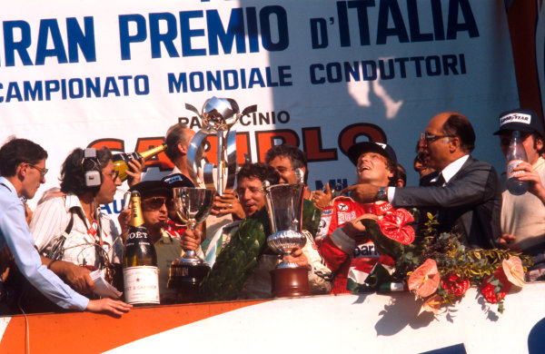 1977 Italian Grand Prix.Monza, Italy. 9-11 September 1977.Mario Andretti (Lotus Ford) 1st position, Niki Lauda (Ferrari) 2nd position and Alan Jones (Shadow Ford) 3rd position on the podium. Ref-77 ITA 07.World Copyright - LAT Photographic