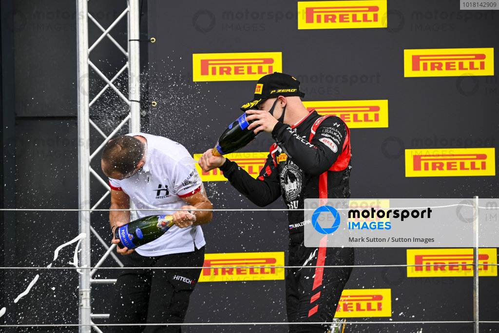 Nikita Mazepin (RUS, HITECH GRAND PRIX), 1st position, sprays the victory Champagne on the podium with his team mate