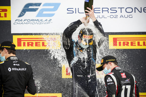 Christian Lundgaard (DNK, ART GRAND PRIX), race Winner Dan Ticktum (GBR, DAMS) and Louis Deletraz (CHE, CHAROUZ RACING SYSTEM) celebrate on the podium with the champagne