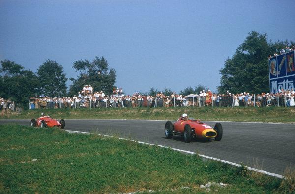 Monza, Italy. 6-8 September 1957. Wolfgang von Trips (Lancia-Ferrari D50 801) leads Giorgio Scarlatti (Maserati 250F). Ref: 57ITA17. World Copyright - LAT Photographic
