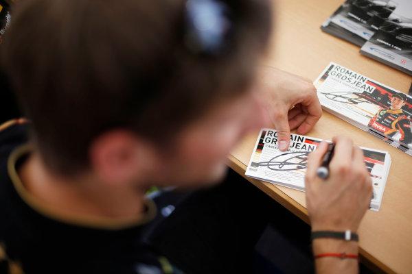 Hockenheimring, Hockenheim, Germany. Saturday 19 July 2014. Romain Grosjean, Lotus F1, signs autographs for fans. World Copyright: Charles Coates/LAT Photographic. ref: Digital Image _J5R4677