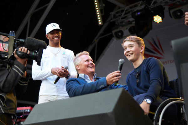Silverstone, Northamptonshire, UK.  Saturday 15 July 2017. Lewis Hamilton, Mercedes AMG, and Johnny Herbert on stage with injured British Formula 4 racer Billy Monger. World Copyright: Steve Etherington/LAT Images  ref: Digital Image SNE12348