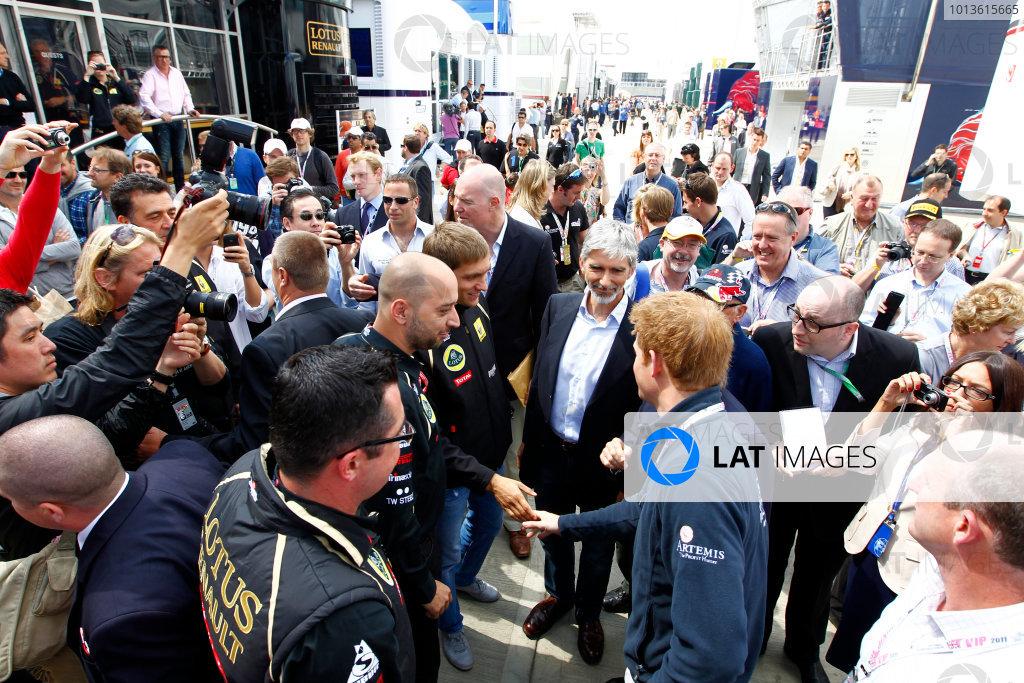 Silverstone, Northamptonshire, England10th July 2011HRH Prince Harry meets Vitaly Petrov, Lotus Renault GP R31. Portrait. VIPs.World Copyright:Charles Coates/LAT Photographicref: Digital Image _W7C3957
