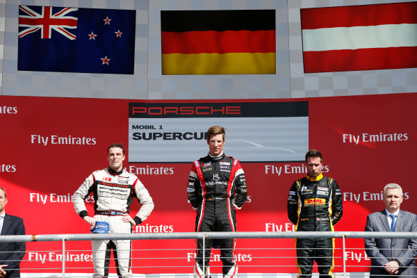 2014 Porsche Supercup. Sunday 2 November 2014. Michael Ammermuller, No.4 Lechner Racing Team, 1st Position, Earl Bamber, No.19 Fach Auto Tech, 2nd Position, and Philipp Eng, No.12 Team Project 1, 3rd Position, on the podium.  World Copyright: /LAT Photographic. ref: Digital Image _89P8523