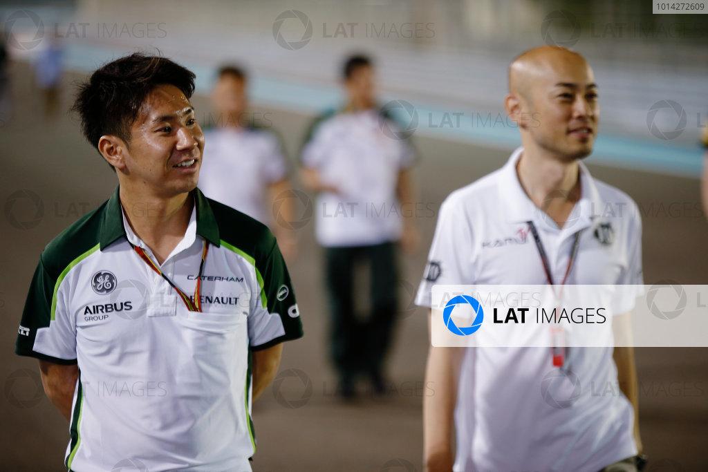 Yas Marina Circuit, Abu Dhabi, United Arab Emirates. Thursday 20 November 2014. Kamui Kobayashi, Caterham F1, walks the track. World Copyright: Charles Coates/LAT Photographic. ref: Digital Image _N7T4659