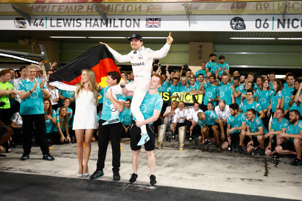 Yas Marina Circuit, Abu Dhabi, United Arab Emirates. Sunday 27 November 2016. Nico Rosberg, Mercedes AMG, 2nd Position and new World Champion, celebrates with his team, friends and family. World Copyright: Andrew Hone/LAT Photographic ref: Digital Image _ONZ0809