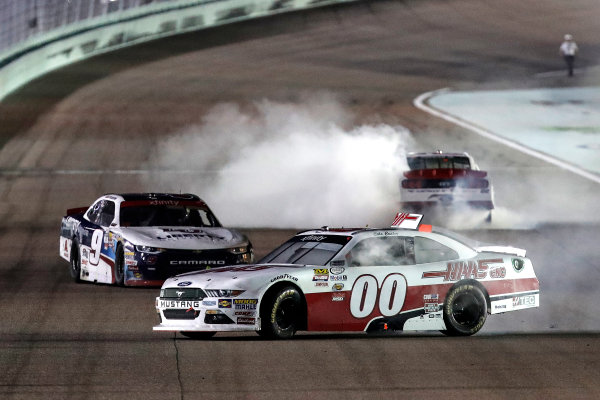 NASCAR XFINITY Series Ford EcoBoost 300 Homestead-Miami Speedway, Homestead, FL USA Saturday 18 November 2017 Cole Custer, Haas Automation Ford Mustang, William Byron, Liberty University Chevrolet Camaro, Sam Hornish Jr, REV/Fleetwood RV Ford Mustang, burnout World Copyright: Michael L. Levitt LAT Images