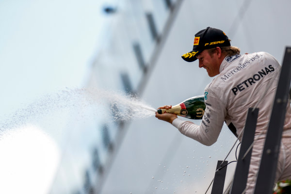 Red Bull Ring, Spielberg, Austria. Sunday 21 June 2015. Nico Rosberg, Mercedes AMG, 1st Position, celebrates on the podium. World Copyright: Alastair Staley/LAT Photographic. ref: Digital Image _R6T7042