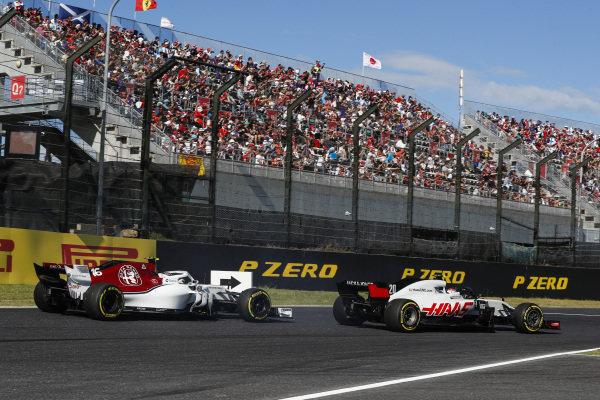 Kevin Magnussen, Haas F1 Team VF-18, leads Charles Leclerc, Sauber C37 Ferrari