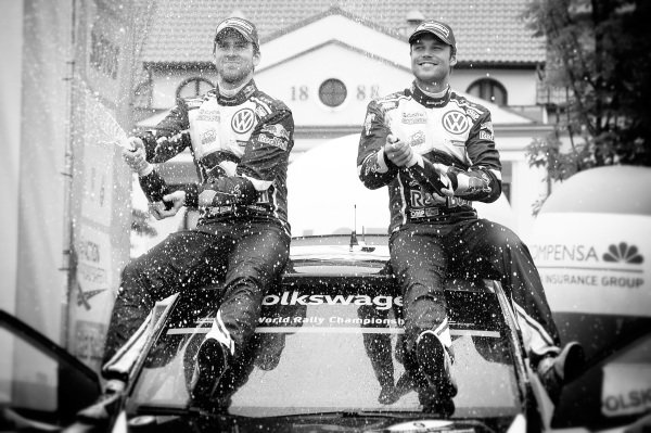 Rally Winners Andreas Mikkelsen (NOR) / Anders Jaeger Synnevag (NOR), Volkswagen Motorsport II WRC celebrate with the champagne at FIA World Rally Championship, Rd7, Rally Poland, Day Three, Mikolajki, Poland, 3 July 2016.