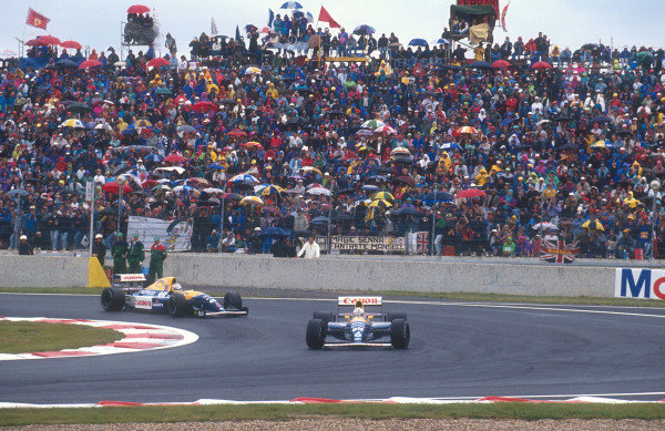 1992 French Grand Prix.Magny-Cours, France.3-5 June 1992.Riccardo Patrese leads teammate Nigel Mansell (both Williams FW14B Renault's) early on in the race. They finished in 2nd and 1st positions respectively.Ref-92 FRA 08.World Copyright - LAT Photographic
