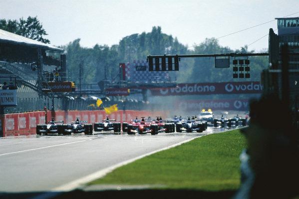 Michael Schumacher, Ferrari F2003-GA, leads Juan Pablo Montoya, Williams FW25 BMW, at the start.