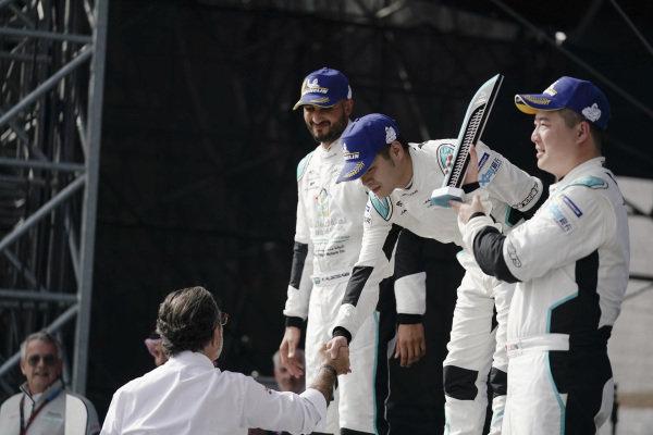 PRO AM class race winner Zhang Yaqi (CHI), Jaguar China Racing on the podium with teammate Sun Chao (CHI), Jaguar China Racing, 3rd position, receiving his trophy