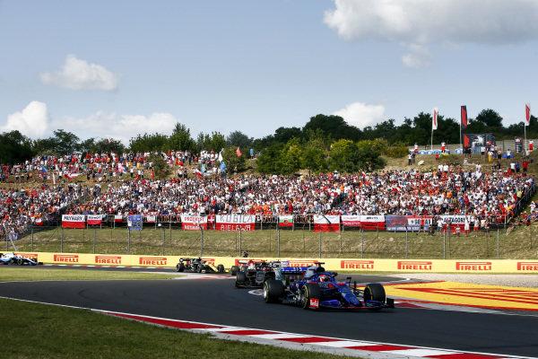 Daniil Kvyat, Toro Rosso STR14, leads Kevin Magnussen, Haas VF-19