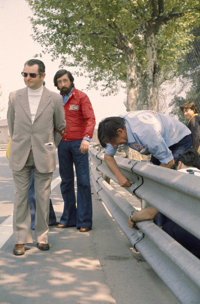 1975 Spanish Grand Prix.Monjuich Park, Spain.25-27 April 1975.Ken Tyrrell examines the armco barriers, which were the subject of concern causing a driver protest.Ref-75 ESP 03.World Copyright - LAT Photographic