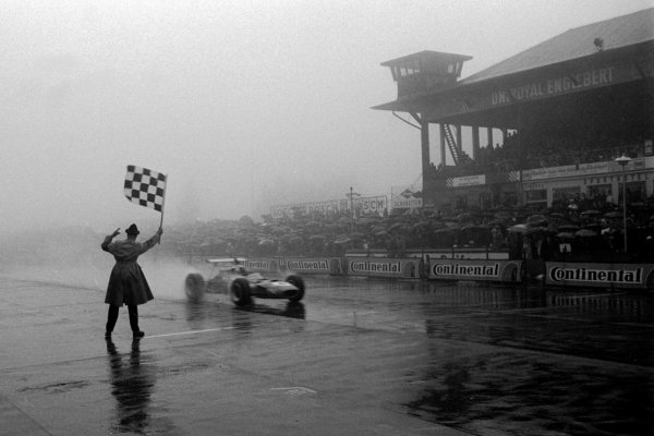 Jackie Stewart (GBR) Matra MS10 receives the chequered flag and wins arguably his greatest ever race, winning by over four minutes in terrifying conditions.     German (European) Grand Prix, Nurburgring, Germany, 4 August 1968.