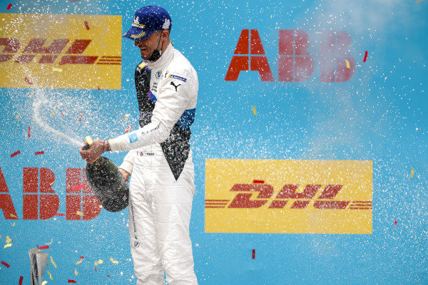 Race Winner Jake Dennis (GBR), BMW I Andretti Motorsport celebrates on the podium with the champagne