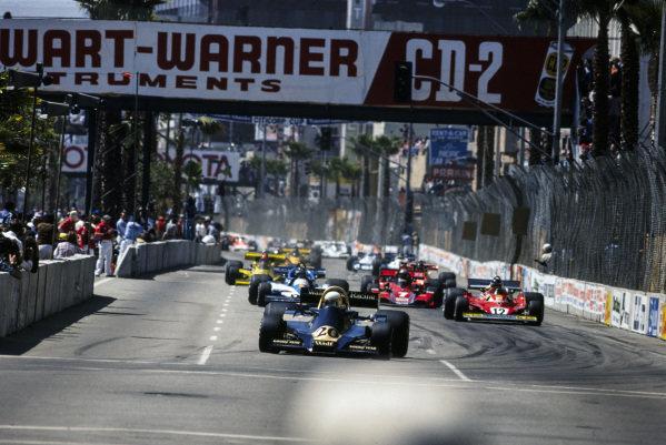Jody Scheckter, Wolf WR1 Ford leads Carlos Reutemann, Ferrari 312T2 and Jacques Laffite, Ligier JS7 Matra.