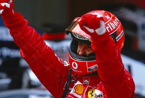 2002 Spanish Grand Prix.Catalunya, Barcelona, Spain. 26-28 April 2002.Michael Schumacher (Ferrari) punches the air in jubilation after taking his 57th Grand Prix victory.Ref-02 ESP 40.World Copyright - LAT Photographic