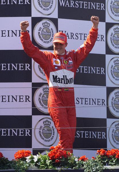 2001 European Grand Prix - Race.Nurburgring, Germany. 24th June 2001.Race winner Michael Schumacher, Ferrari F2001, raises his arms in triumph - podium.World Copyright: Steve Etherington/LAT Photographicref: 14mb Digital Image Only