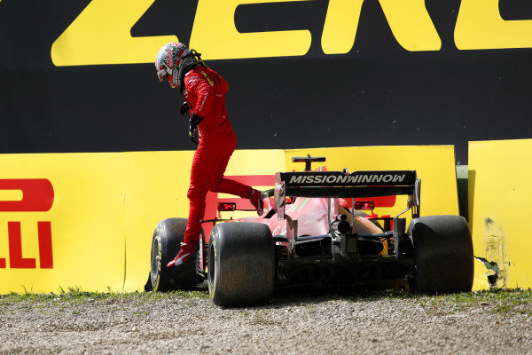 Charles Leclerc, Ferrari SF21, gets out of his car after going off