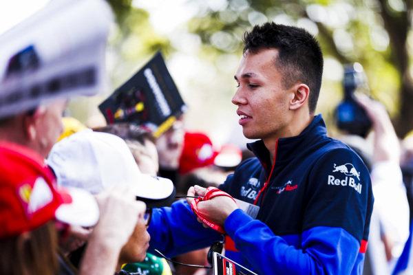 Alexander Albon, Scuderia Toro Rosso signs a autograph for a fan
