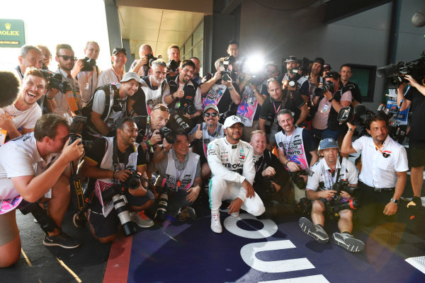 Lewis Hamilton, Mercedes AMG F1, celebrates pole with a group of photographers