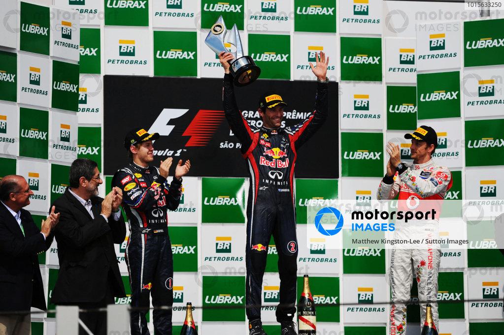 The podium (L to R): Sebastian Vettel (GER) Red Bull Racing, second; Mark Webber (AUS) Red Bull Racing, race winner; Jenson Button (GBR) McLaren, third. Formula One World Championship, Rd 19, Brazilian Grand Prix, Race, Interlagos, Sao Paulo, Brazil, Sunday 27 November 2011.