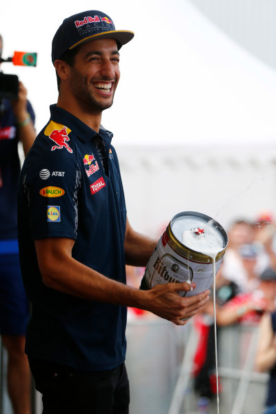 Hockenheim, Germany. Saturday 30 July 2016. Daniel Ricciardo, Red Bull Racing, holds an oversize, leaking, beercan.  World Copyright: Andy Hone/LAT Photographic ref: Digital Image _ONY7720