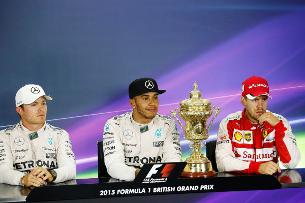 Silverstone Circuit, Northamptonshire, England. Sunday 5 July 2015. Lewis Hamilton, Mercedes AMG, 1st Position, Nico Rosberg, Mercedes AMG, 2nd Position, and Sebastian Vettel, Ferrari, 3rd Position, in the Press Conference. World Copyright: Alastair Staley/LAT Photographic ref: Digital Image _R6T7630
