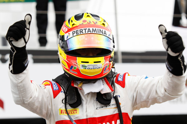 2015 GP2 Series Round 5.  Silverstone, Northamptonshire, England. Sunday 5 July 2015.  Rio Haryanto (INA, Campos Racing) celebrates his win in Parc Ferme. Photo: Sam Bloxham/GP2 Media Service  ref: Digital Image _G7C1965