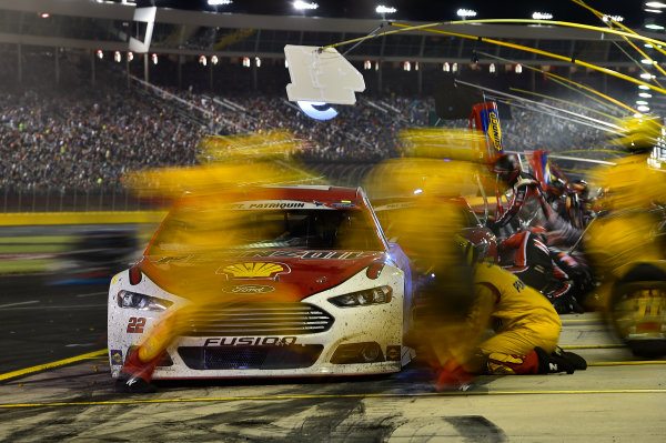 21-24 May, 2015, Concord, North Carolina USA Joey Logano (22) makes a pit stop. ?2015, John Harrelson / LAT PHOTO USA