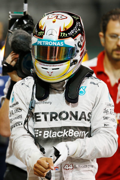 Yas Marina Circuit, Abu Dhabi, United Arab Emirates. Saturday 22 November 2014. Lewis Hamilton, Mercedes AMG, arrives in Parc Ferme after Qualifying. World Copyright: Steven Tee/LAT Photographic. ref: Digital Image _X0W0069