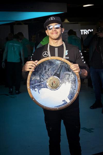 Albert Park, Melbourne, Australia. Sunday 15 March 2015. Lewis Hamilton, Mercedes AMG with the race winner's trophy. World Copyright: Steve Etherington/LAT Photographic. ref: Digital Image SNE11642