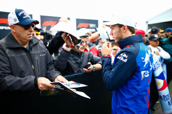 Pierre Gasly, Toro Rosso, signs autographs for fans.
