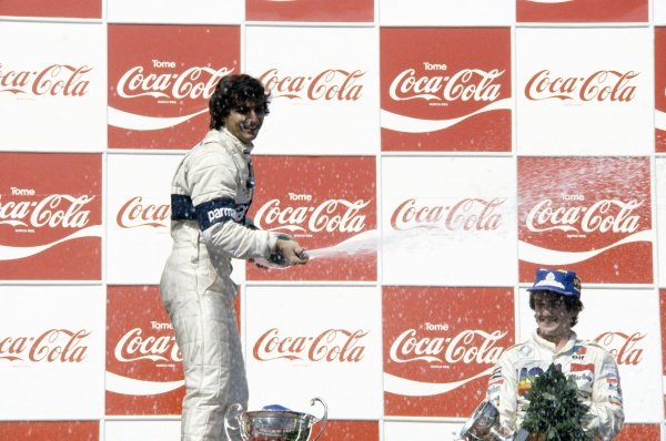 1981 Argentinian Grand Prix.Buenos Aires, Argentina. 10-12 April 1981.Nelson Piquet (Brabham BT49C-Ford Cosworth), 1st position, and Alain Prost (Renault RE20), 3rd position, on the podium.World Copyright: LAT PhotographicRef: 35mm transparency 81ARG03