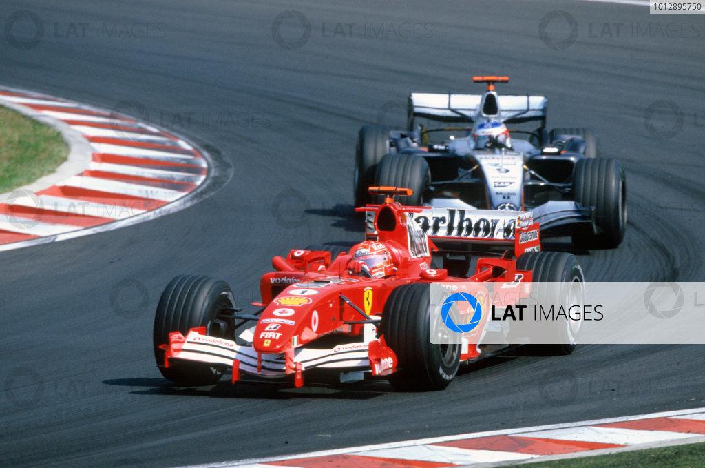 2005 Hungarian Grand Prix. Hungaroring, Hungary. 29th - 31st July 2005 Michael Schumacher, Ferrari F2005 leads Kimi Raikkonen, McLaren Mercedes MP4-20. Action. World Copyright: Michael Cooper/LAT Photographic Ref: 35mm Image A06