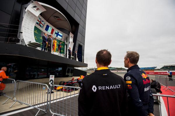 2017 GP3 Series Round 3.  Silverstone, Northamptonshire, UK. Sunday 16 July 2017. Alan Permane, Renault and Jonathan Wheatley, Red Bull Racing watch the podium. Photo: Zak Mauger/GP3 Series Media Service. ref: Digital Image _54I5955
