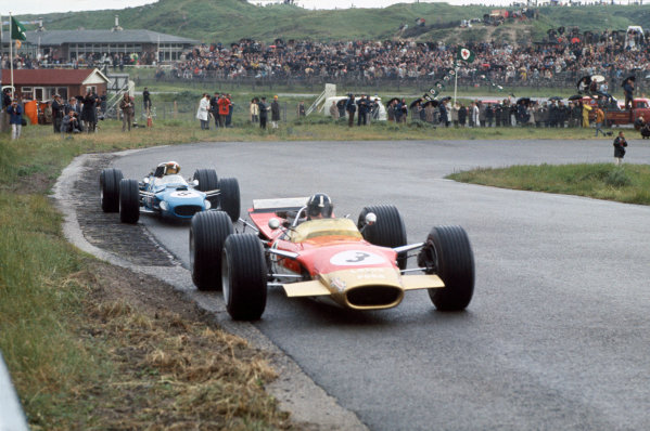 Zandvoort, Holland. 21-23 June 1968.Graham Hill (Lotus 49B-Ford), 9th position, leads Jackie Stewart (Matra MS10-Ford), 1st position, action. World Copyright: LAT PhotographicRef: 68HOL24.
