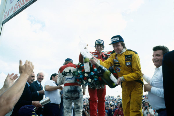 Paul Ricard, Le Castellet, France. 30th June -2nd July 1978. Mario Andretti (Lotus 79-Ford) 1st position, with Ronnie Peterson (Lotus 79-Ford) 2nd position and James Hunt (McLaren M26-Ford) 3rd position, on the podium, portrait.  World Copyright: LAT Photographic. Ref: 78FRA26