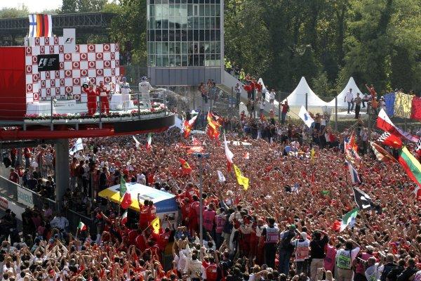 2006 Italian Grand Prix - Sunday Race Autodromo Nazionale Monza, Italy. 7th - 10th September 2006. Michael Schumacher, Ferrari 248F1, 1st position, celebrates on the podium, portrait. World Copyright: Michael Cooper/LAT Photographic ref: Digital Image IMG_0731