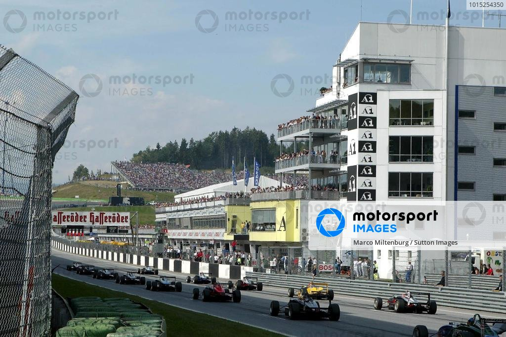 The start of round 14 with the pit complex in the background, due to be redeveloped. F3 Euro Series, Rd13 & Rd14, A1-Ring, Austria, 7 September 2003. DIGITAL IMAGE