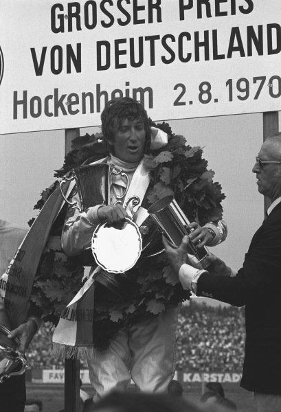1970 German Grand Prix. Hockenheim, Germany. 31st July - 2nd August 1970. Jochen Rindt (Lotus 72C-Ford), 1st position, on the podium, portrait.  World Copyright: LAT Photographic. Ref: 3232 - 7.
