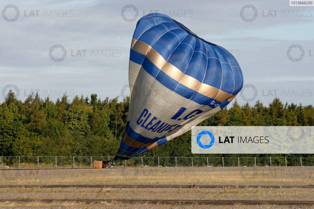Rockingham, Northamptonshire. 17th - 18th September 2011.A hot air balloon lands at Rockingham.World Copyright: Ebrey/LAT Photographic.